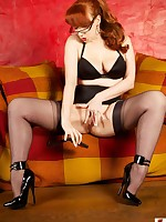 Watch this horny fetish wife pose on her bed in a sexy dress